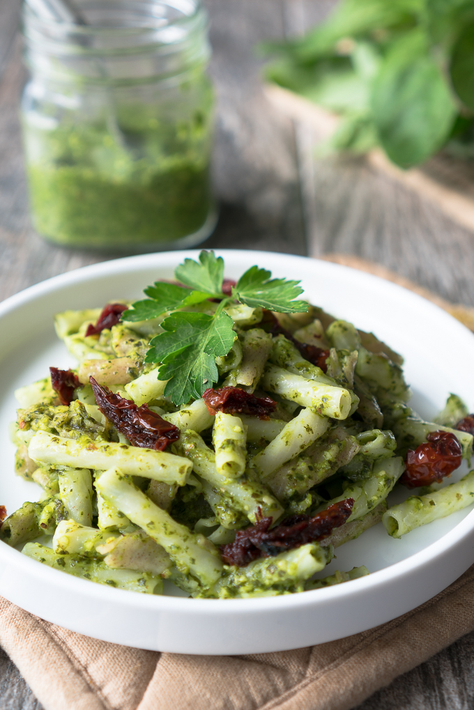 Spicy Green Pesto - Healthy recipe for Spicy Green Pesto! Vegan, gluten-free, & ready in 10 minutes. Uses baby kale, fresh basil, serrano peppers, garlic, almonds, lemon juice & olive oil. Perfect for sprucing up pasta, macro-bowls, flatbreads, or morning eggs! ♥ | freeyourfork.com