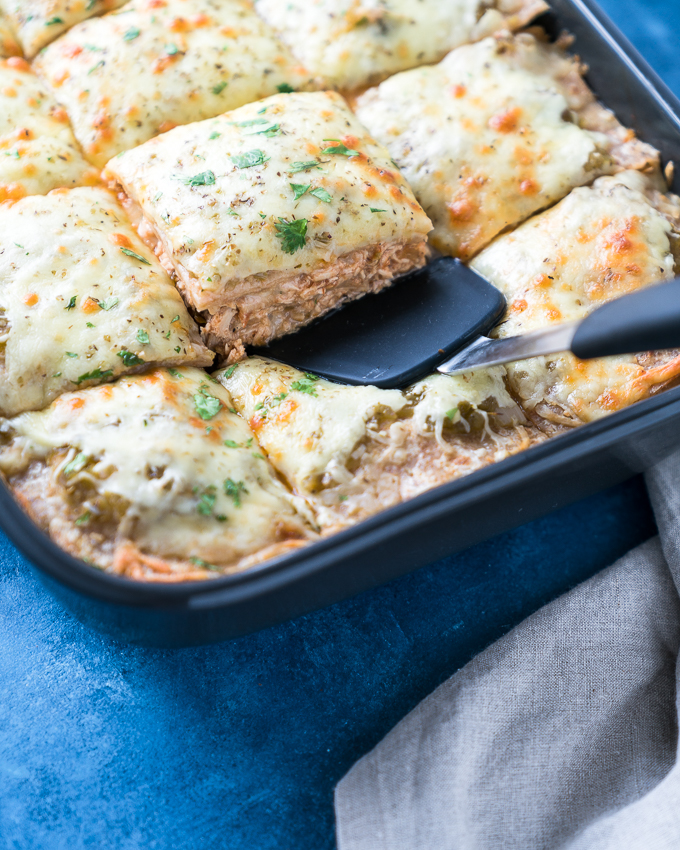 Green Chicken Enchilada Casserole - A healthy recipe for Green Chicken Enchilada Casserole! Baked in the oven with layers of soft tortillas, melty cheese, lean shredded chicken, white beans, salsa verde, and hatch chiles. Perfect for weekly meal-prep!! ♥ | freeyourfork.com