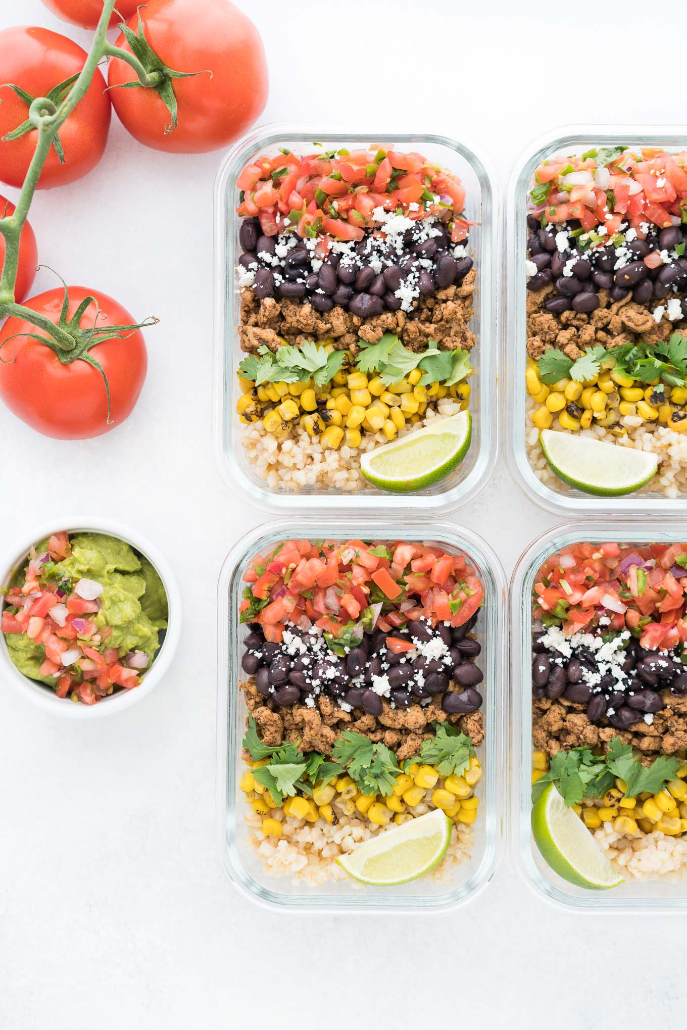 Meal Prep Burrito Bowls with Guacamole Dish and Tomatoes