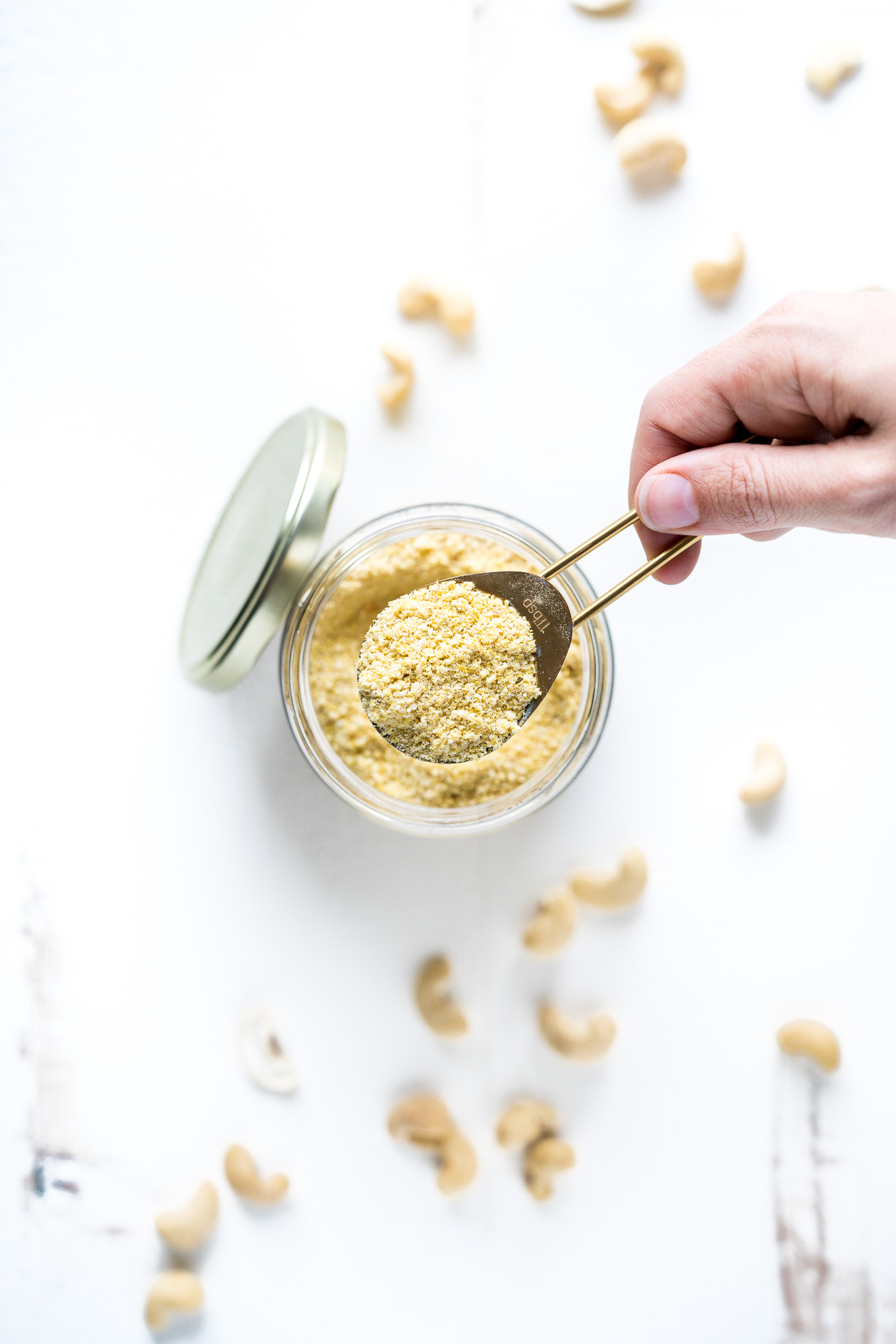 Vegan Parmesan Cheese Spoon Out of Jar