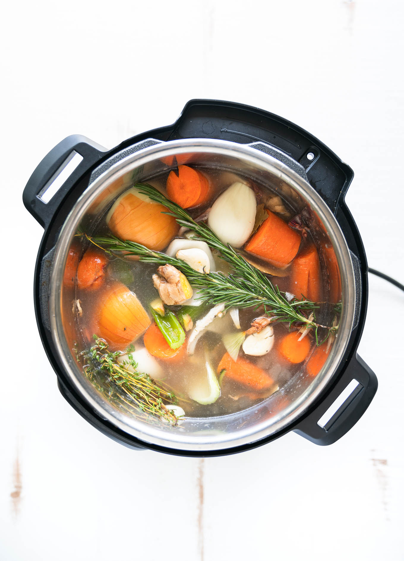Instant Pot Bone Broth with veggies just covered in water