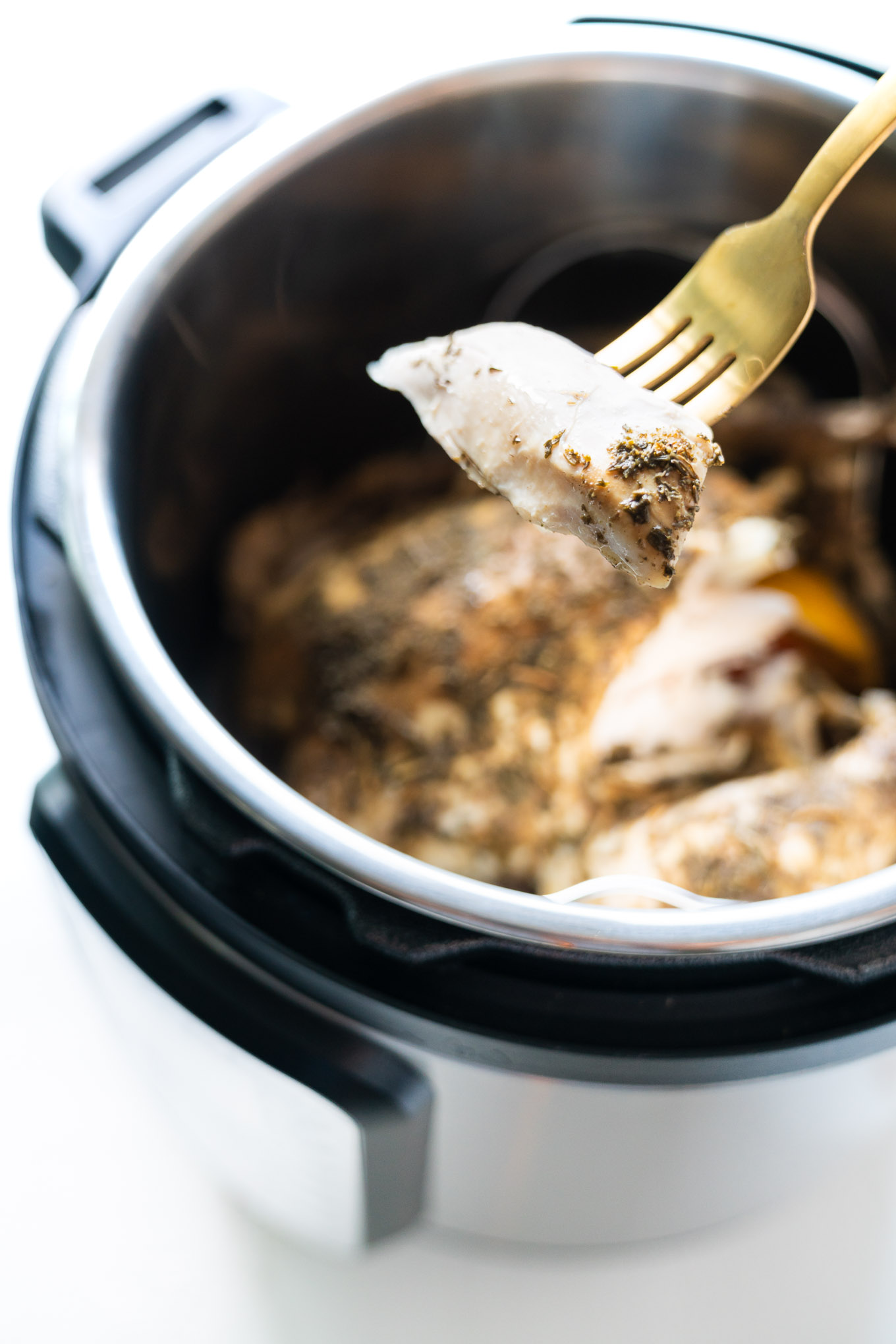 Instant Pot Whole Chicken with gold fork