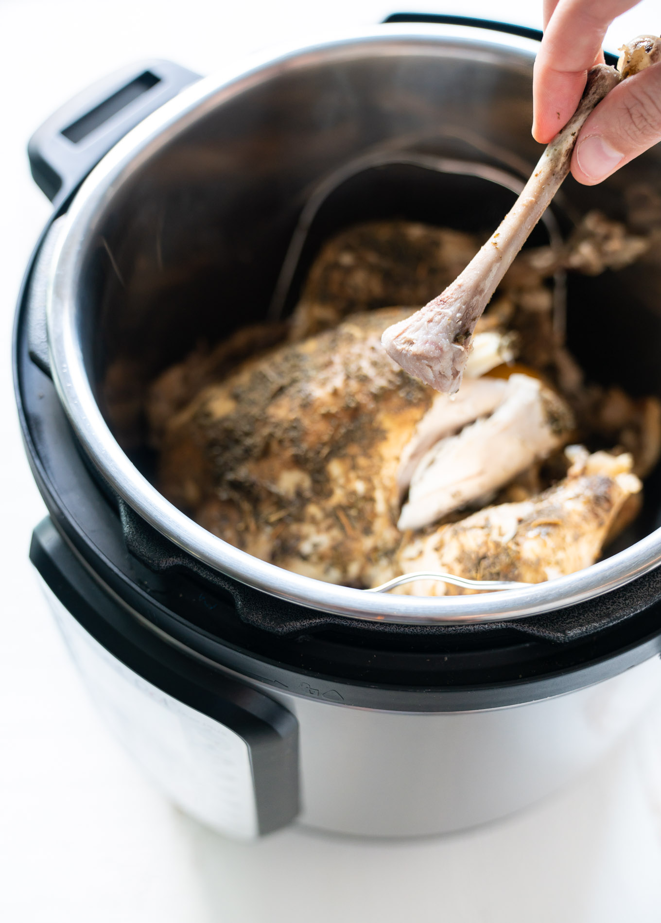 Instant Pot Whole Chicken shown with bone