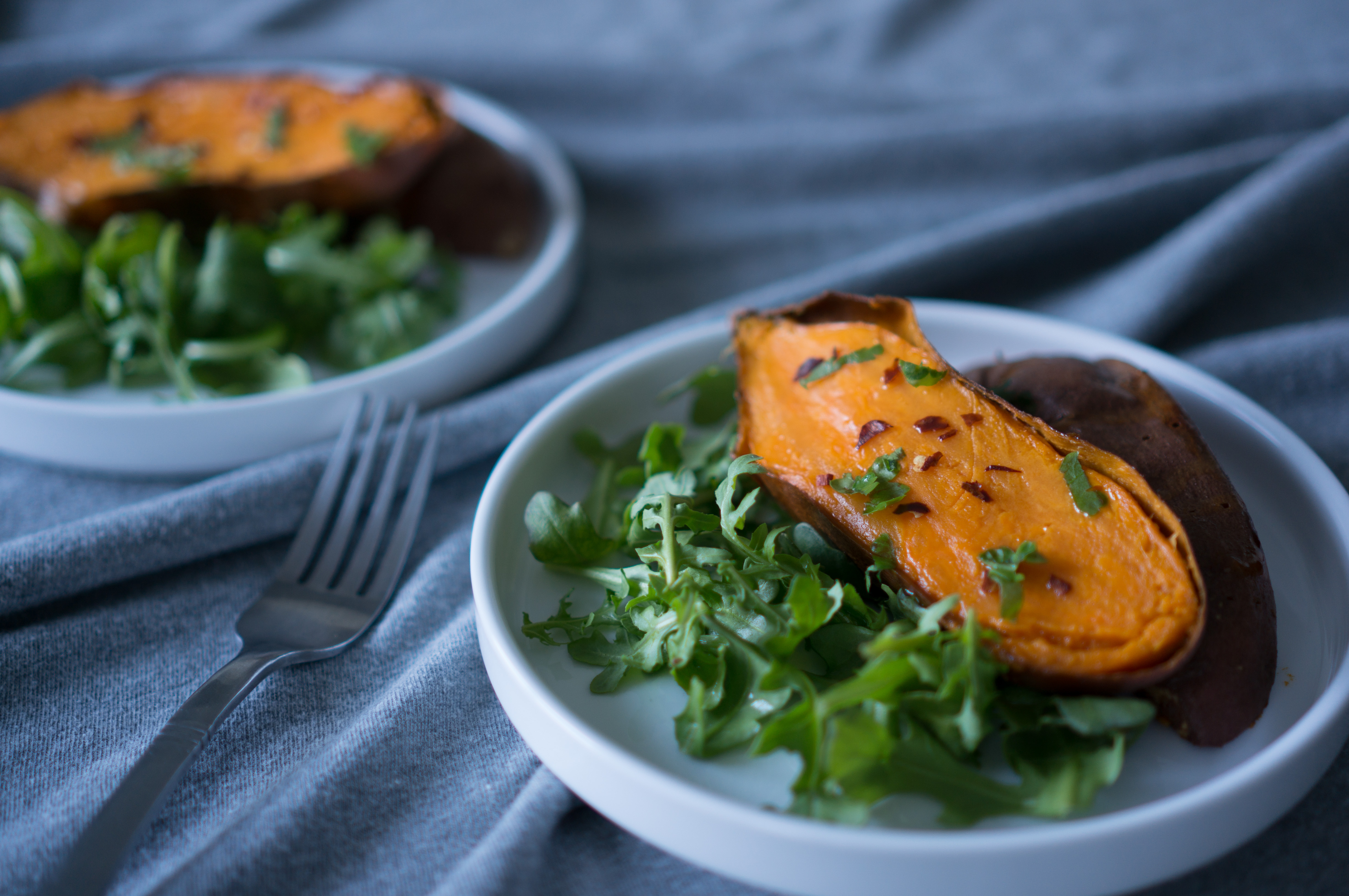 Slow Roasted Sticky Sweet Potatoes - We love this simple, vegan recipe for Slow Roasted Sticky Sweet Potatoes! Just 2 ingredients (olive oil + sweet potatoes) & a hot oven are all you need for perfectly caramelized sweet potatoes every time | freeyourfork.com