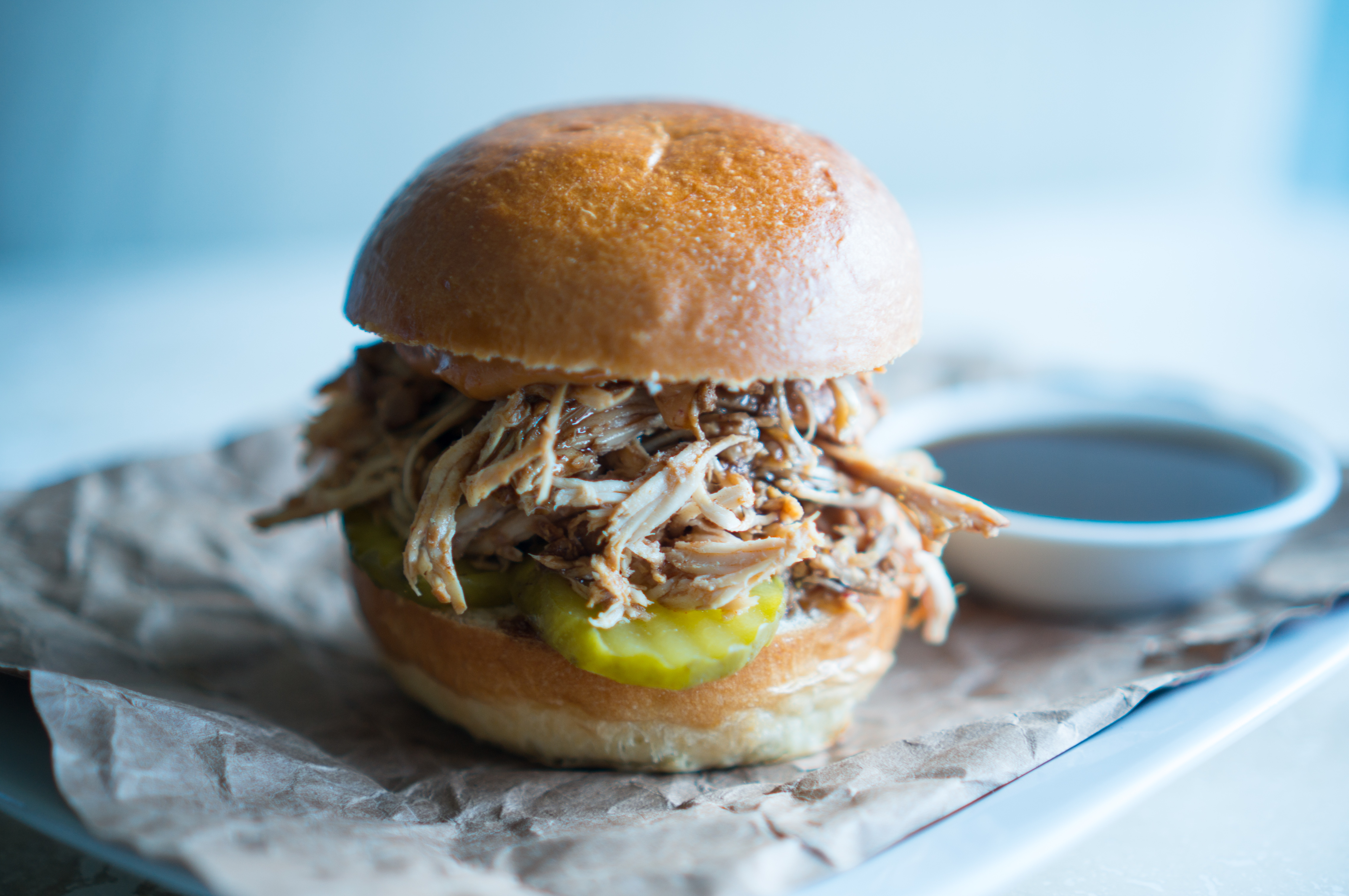 BBQ Pulled Chicken Sliders – Easy Crockpot Shredded Chicken makes this BBQ Pulled Chicken Slider recipe a cinch to pull off for weeknight dinners or weekend gatherings! Lean, protein-packed chicken + sweet BBQ sauce + smokey chipotle mayo + crunchy pickles all loaded up on a baby brioche bun. We love how easy these tasty little sliders are to assemble! They are a total life-saver for those parties where you have LOTS of mouths to feed but don't want to get stuck in the kitchen all night! ♥ | freeyourfork.com
