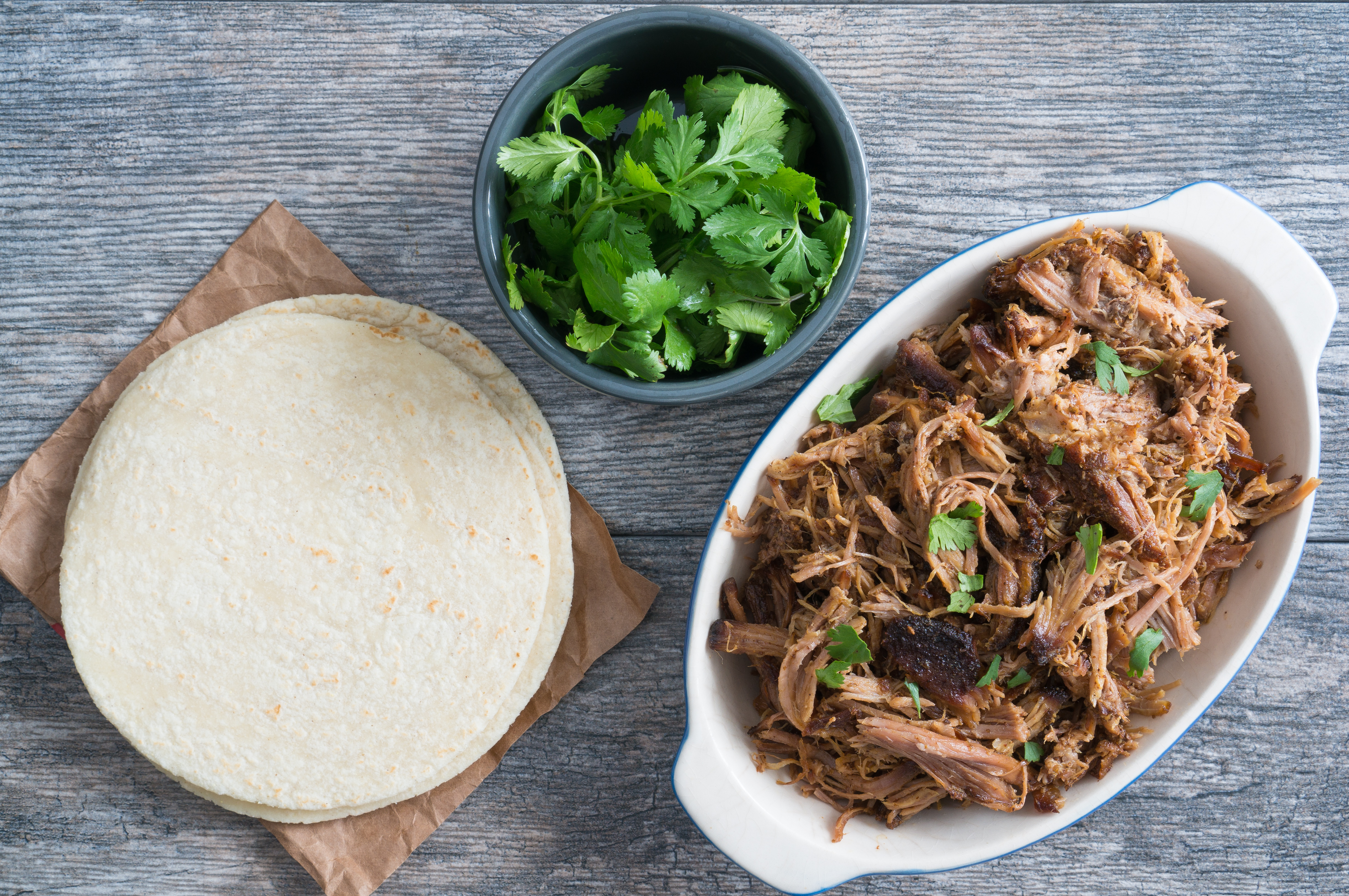Crispy Crockpot Carnitas – Easy recipe for homemade Crispy Crockpot Carnitas. Gluten-free and paleo-friendly! Perfect for tacos, burritos, nachos, enchiladas, sandwiches, and more! Just combine pork shoulder with a simple dry-rub & a squeeze of citrus, then let your slow cooker do the rest. We love this on top of eggs for a quick, savory breakfast! ♥ | freeyourfork.com