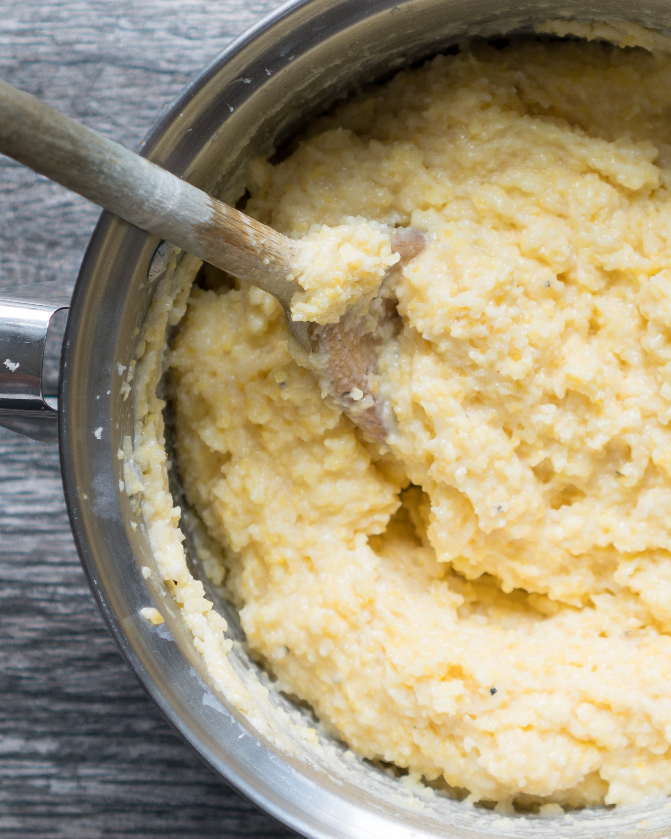 Creamy Parmesan Polenta – Simple stovetop recipe for Creamy Parmesan Polenta! Cooked in broth, almond milk, & fresh garlic with parmesan and creamy cottage cheese melted right in. A gluten-free dinner ready in under 30 min! ♥ | freeyourfork.com