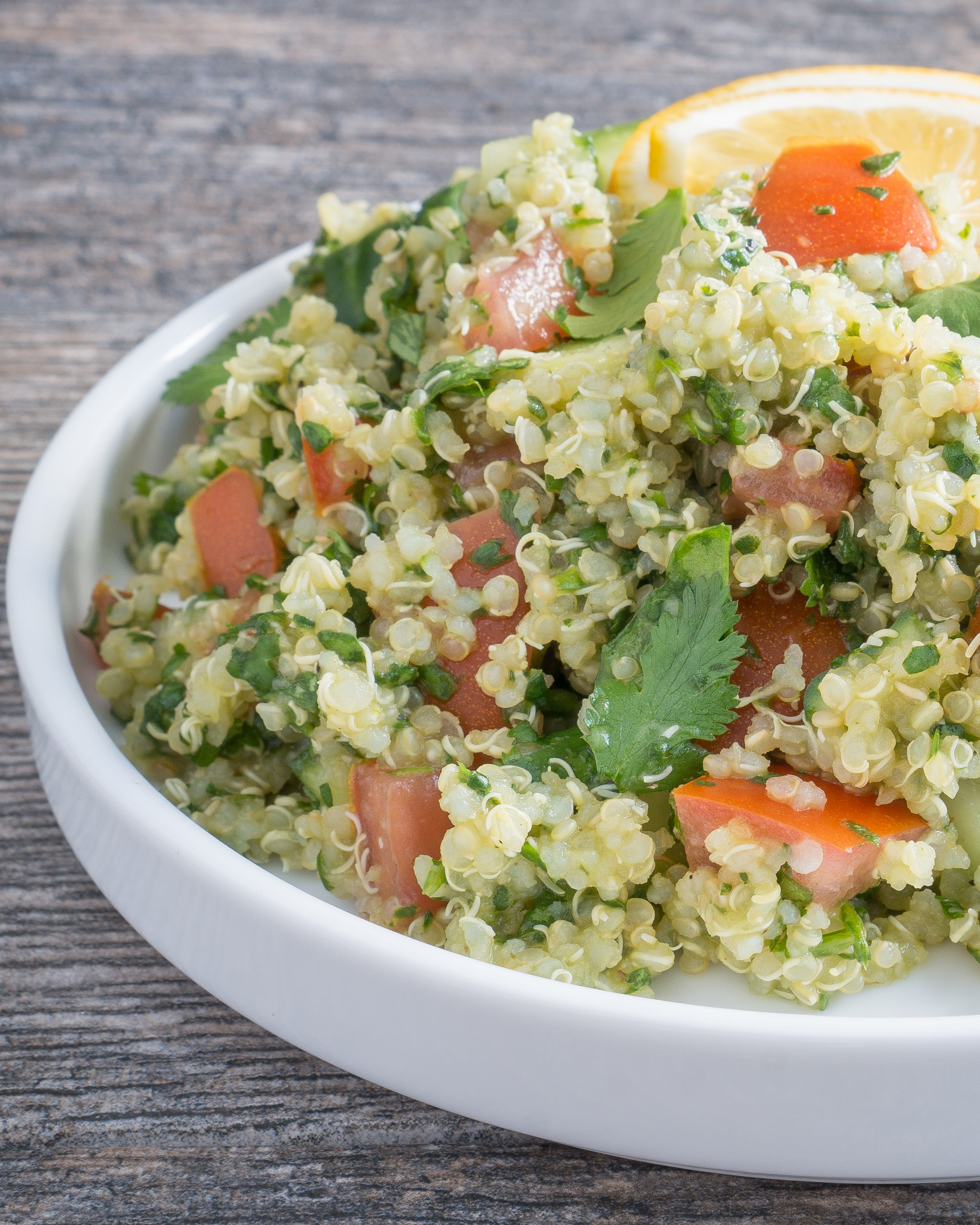 Quinoa Tabbouleh Salad – This Quinoa Tabbouleh Salad is a gluten-free version of the traditional bulgur wheat recipe. This salad has a light lemon & olive oil dressing. Plus it's packed with chopped spinach, fresh parsley, crisp cucumber, tomato, and quinoa! ♥ | freeyourfork.com
