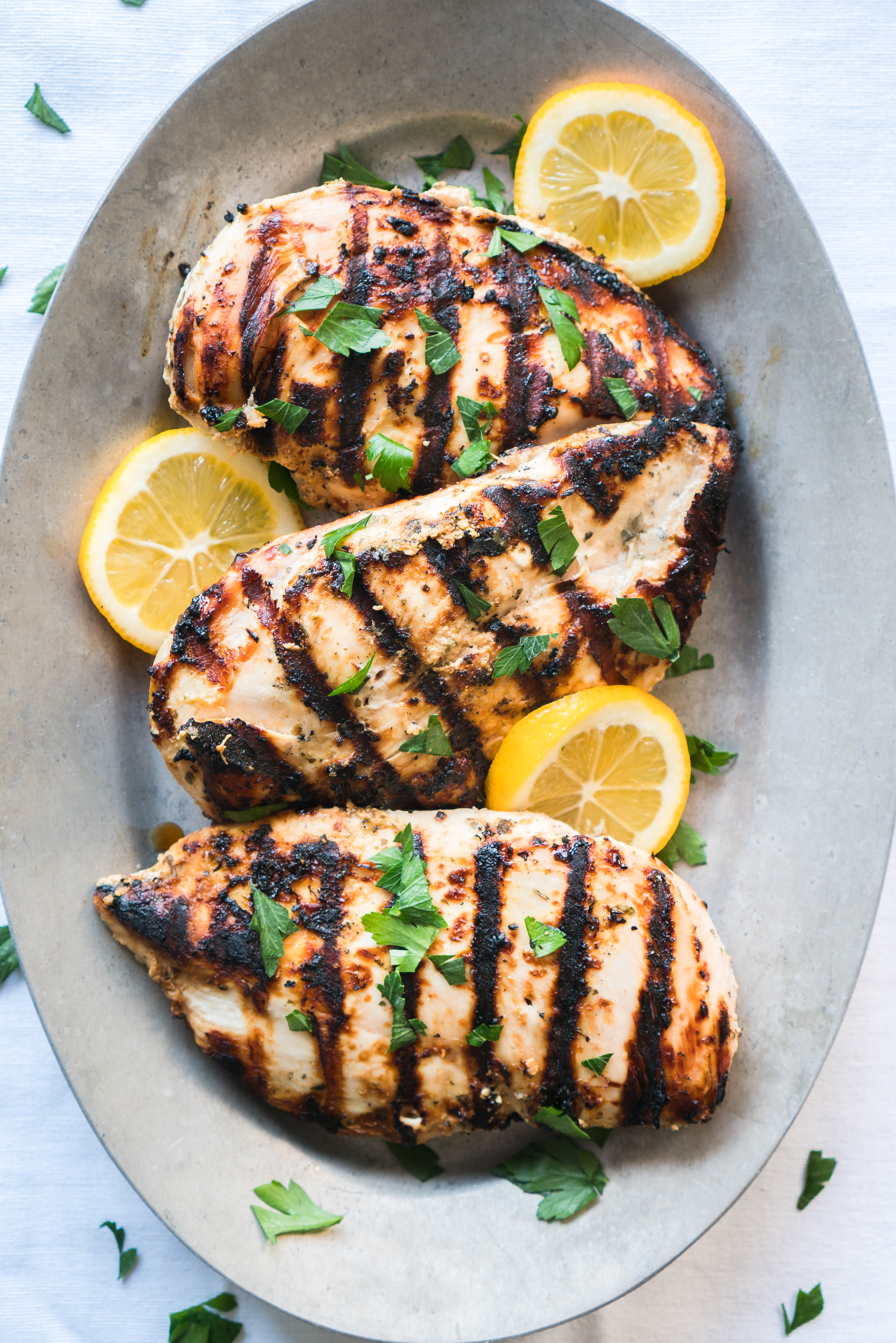 Yogurt Marinated Greek Chicken – Healthy recipe for Yogurt Marinated Greek Chicken! These easy gluten free, grilled chicken breasts cook in just 12 minutes! This marinade is bursting with classic Mediterranean flavors like Greek yogurt, lemon juice, garlic, oregano, basil, coriander, parsley, olive oil, & red wine vinegar. ♥ | freeyourfork.com