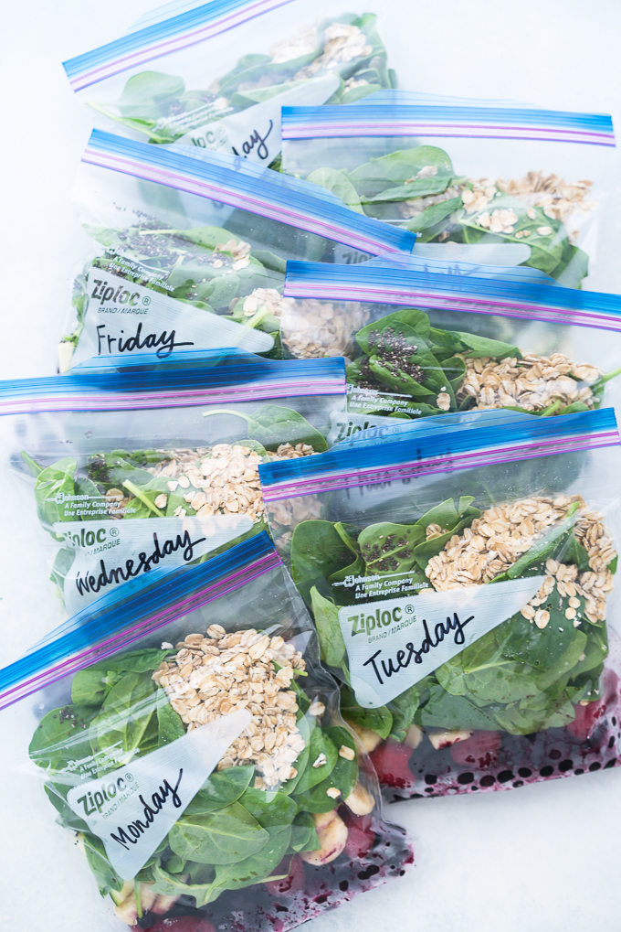 Berry Green Smoothie (Meal Prep) - This healthy recipe uses mixed berries, spinach, Greek yogurt, oats, chia seeds, almond milk, and even zucchini! Perfect for meal prepping, you can pre-portion ingredients into freezer bags for easy grab-and-blend convenience during the week ♥ | freeyourfork.com