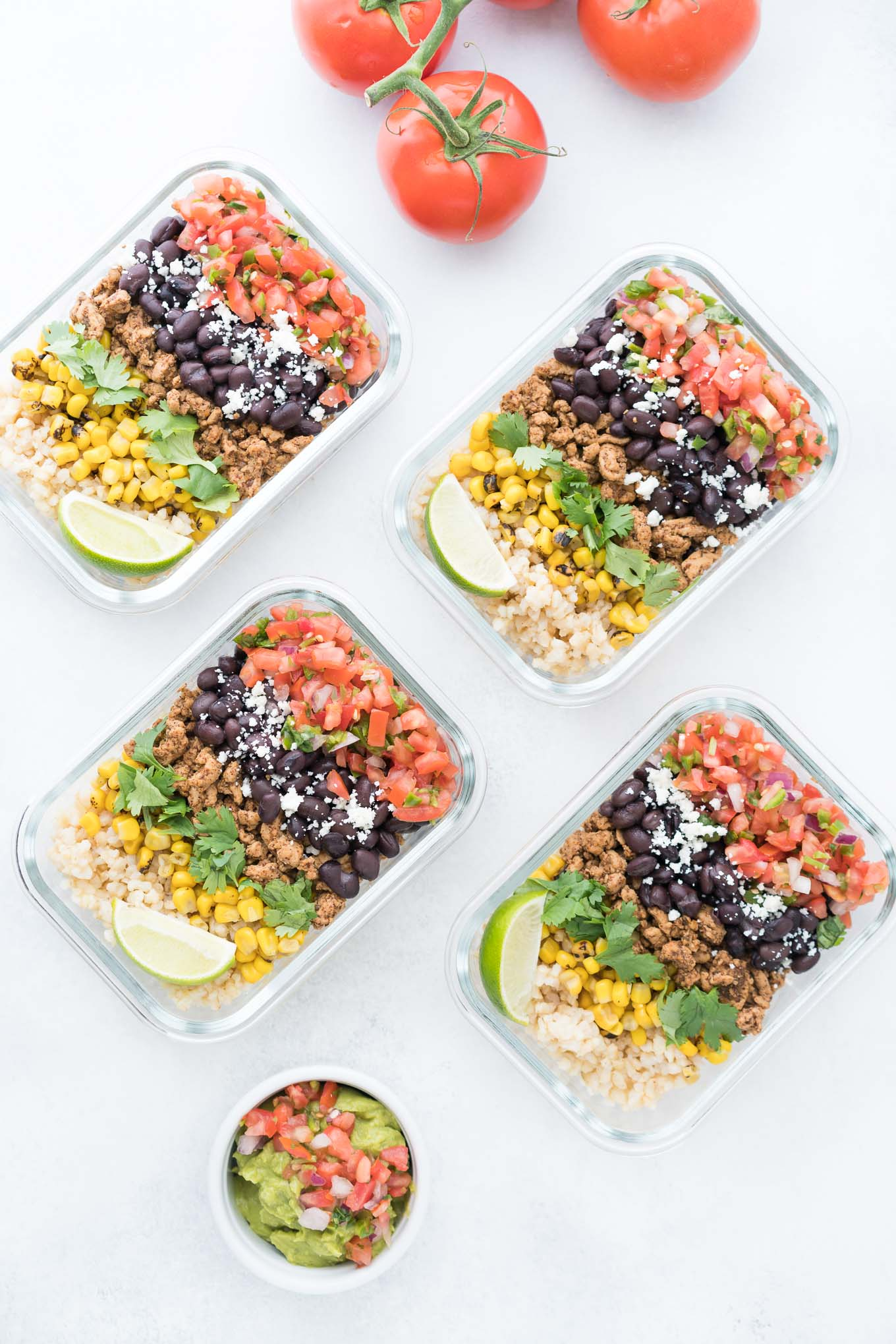 Four Glass Containers of Meal Prep Burrito Bowls