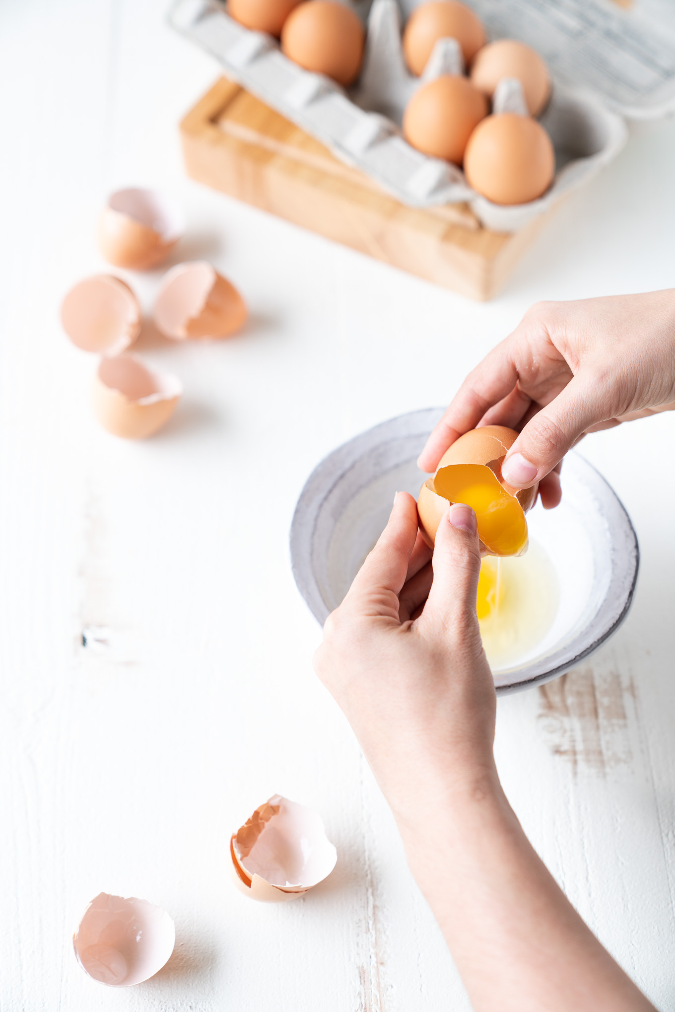 Are pasture-raised eggs better for you - carton with bowl and cracked egg