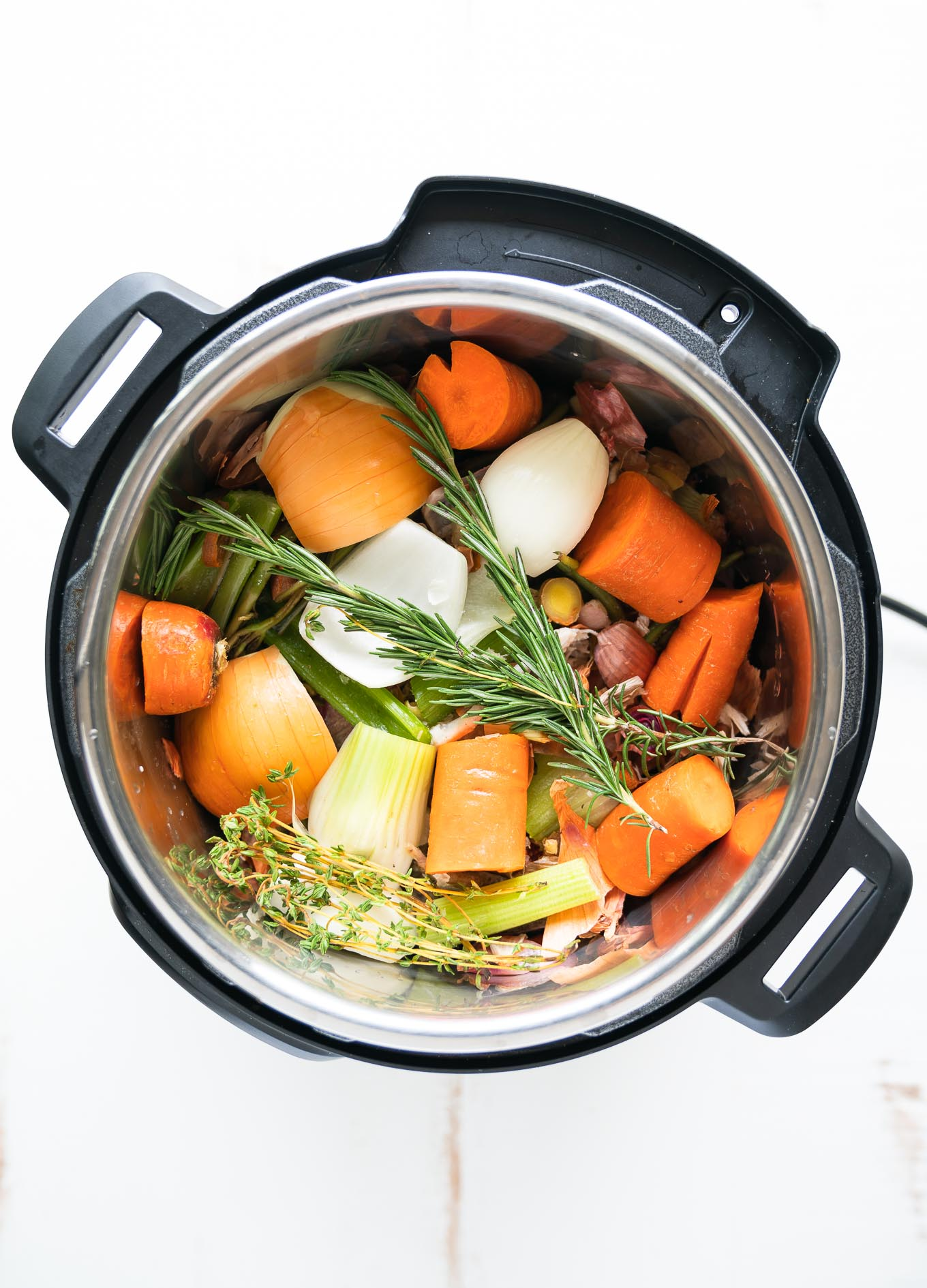 Instant Pot Bone Broth with vegetables inside pot