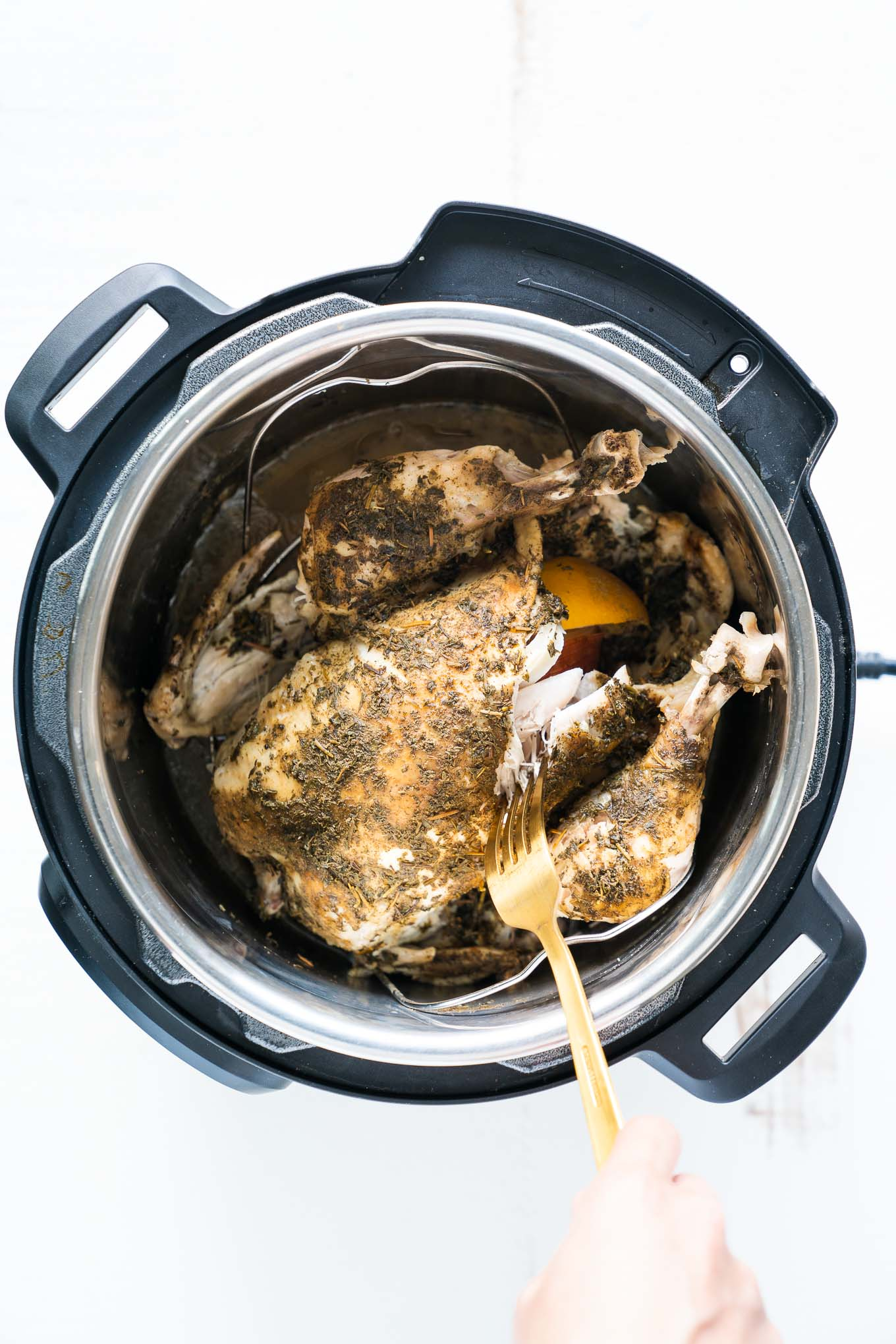 Instant Pot Whole Chicken shown after pressure cooking