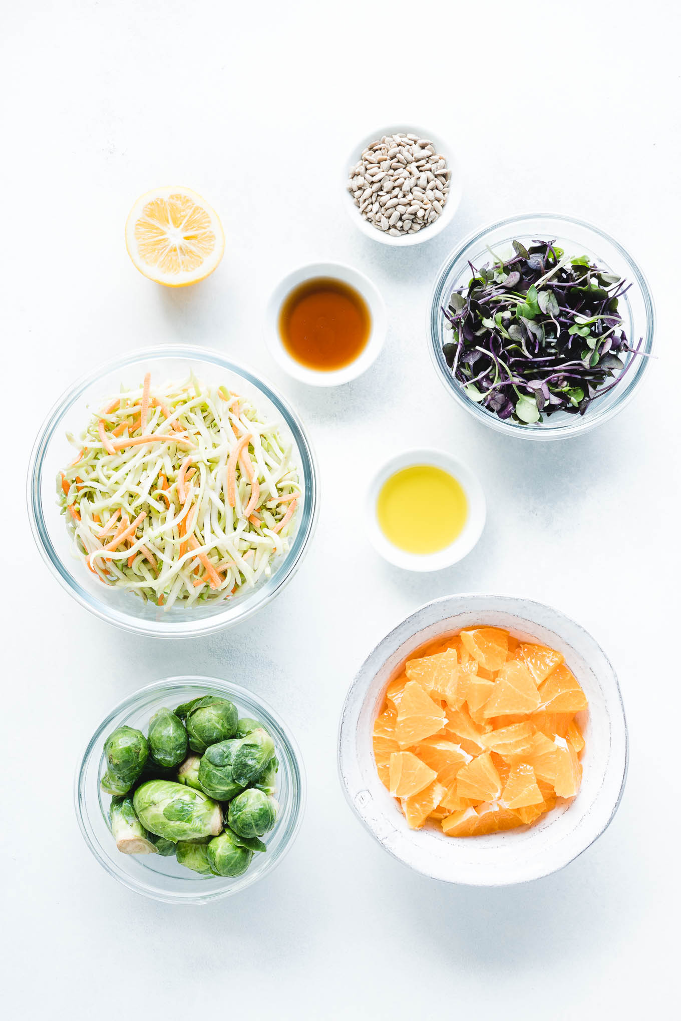 Raw Brussels Sprout Salad with Oranges Ingredients In Bowls