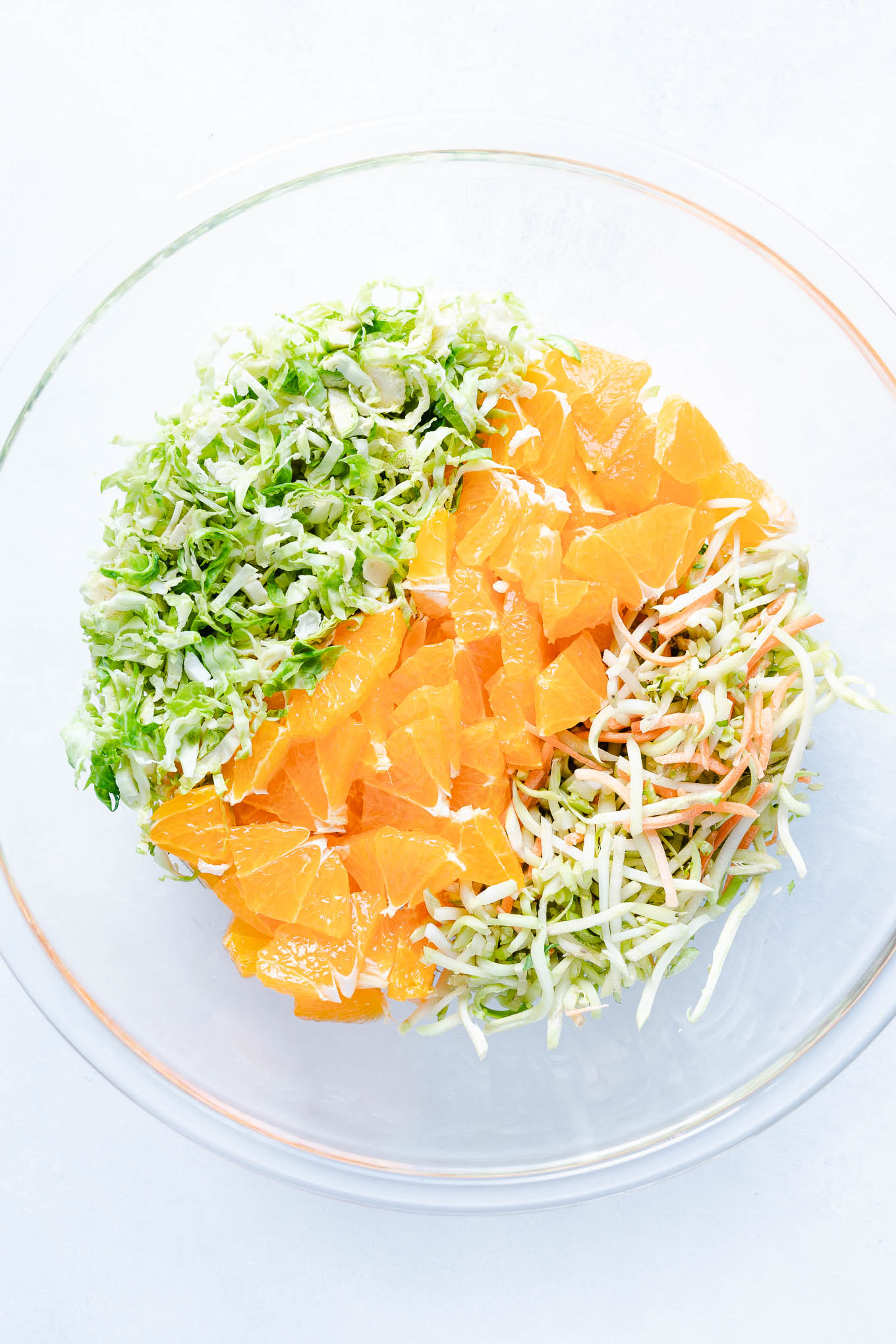 Raw Brussels Sprout Salad with Oranges - Brussels Sprouts, Oranges, Broccoli Slaw in Bowl