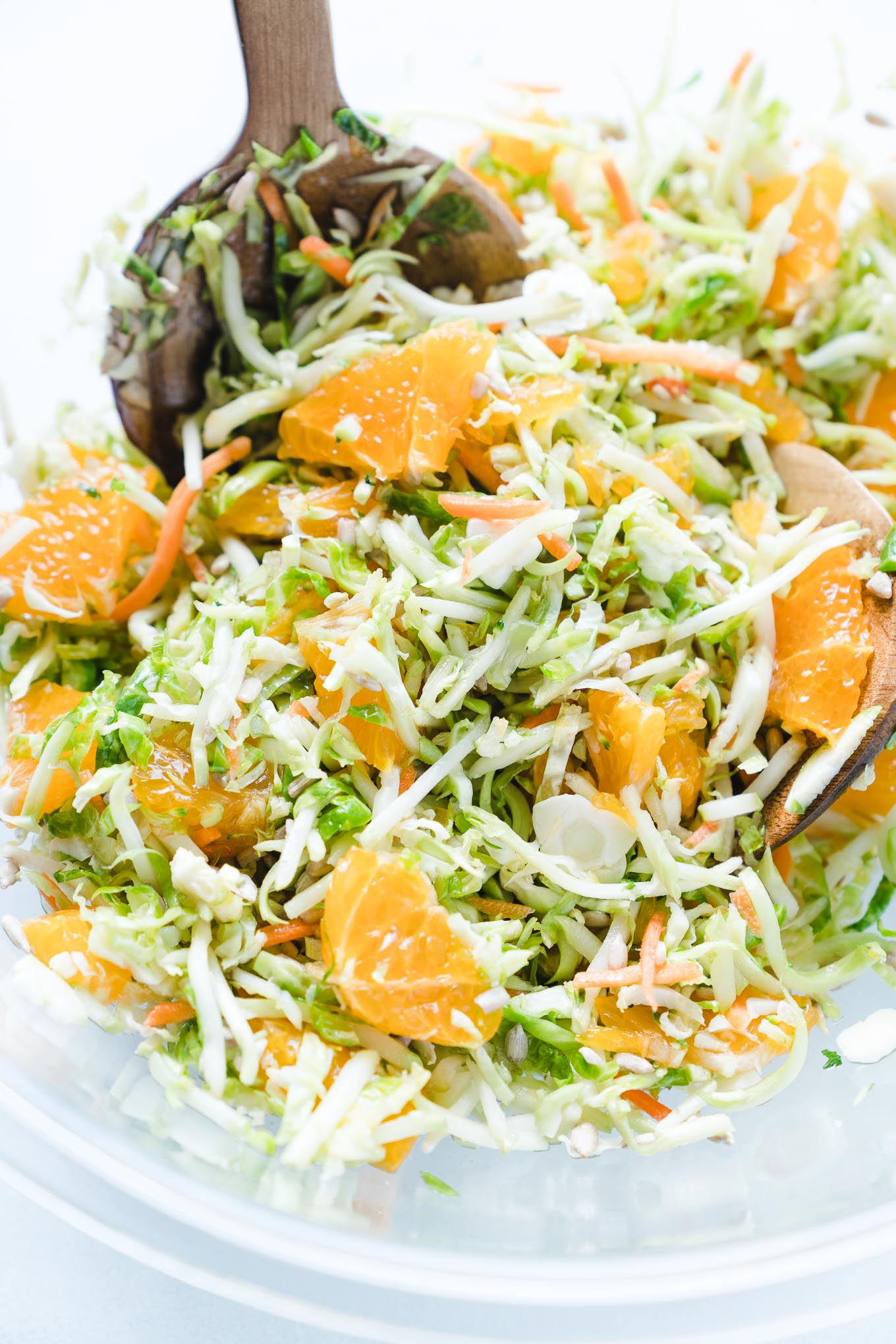 Raw Brussels Sprout Salad with Oranges Bowl with Spoon