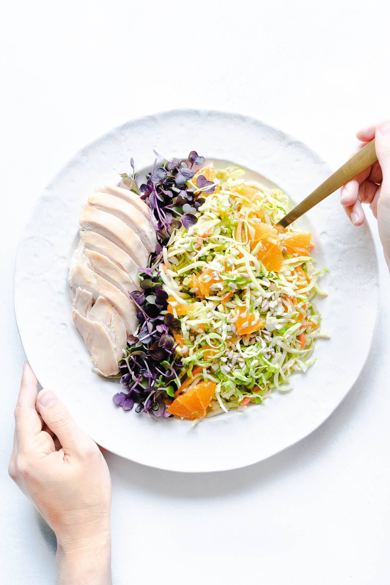 Raw Brussels Sprout Salad with Oranges - Plated with Chicken and Sprouts