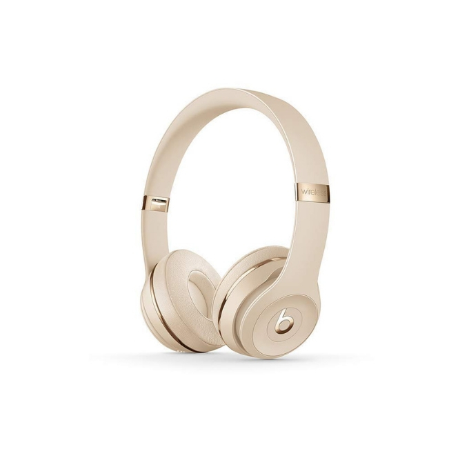 Gold wireless headphones with Beats logo on them